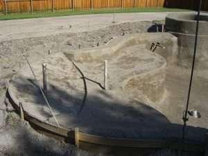 Etapa da execução de projeto de Construção de piscina com prainha.